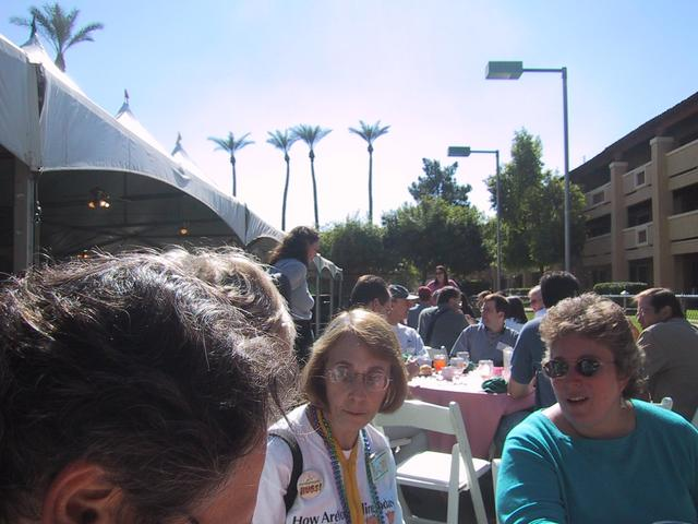Lunch with palmtrees at AYE, in the foreground Naomi Karten and Johanna Rothman