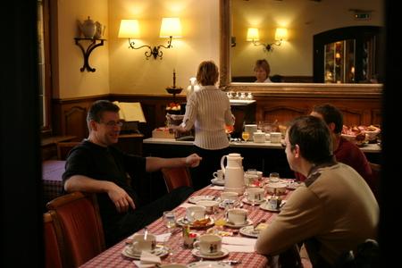 The Belgians (Peter Janssens, Patrick Debois en Koen van Exem) at breakfast